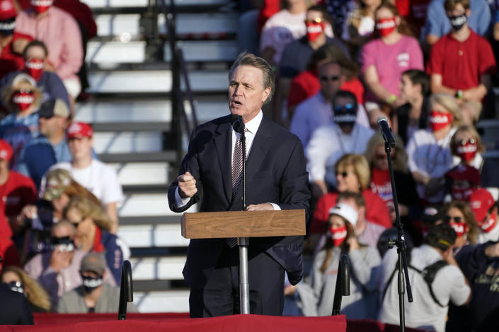 Sen. David Perdue, R-Ga., speaks during a campaign rally for President Donald Trump at Middle Georgia Regional Airport, Friday, Oct. 16, 2020, in Macon, Ga. (AP Photo/John Bazemore)