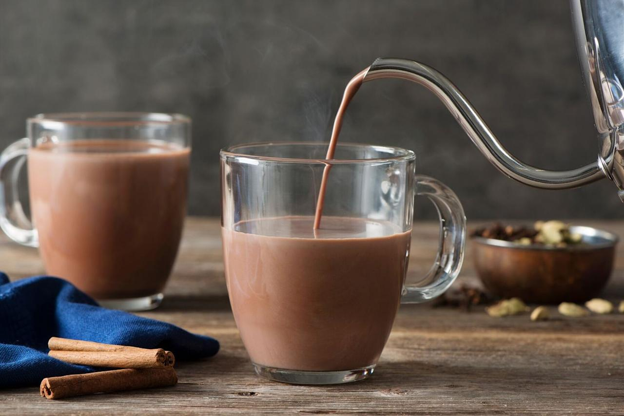 <p>In saucepan, heat 4 C milk, 4 ¼ inch slices fresh ginger, 12 green cardamom pods, 4 peppercorns, 2 whole cloves and a cinnamon stick. Stir often, for about 5 minutes or until hot and steaming. Stir in ¾ C Godiva Milk Chocolate Hot Cocoa; remove from heat. Add a black tea bag; steep for 4 minutes. Strain and divide among 4 mugs. Garnish each serving with a cinnamon stick.</p><p><em>Recipe by Godiva</em></p>