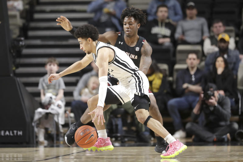 Vanderbilt guard Scotty Pippen Jr., left, drives against South Carolina guard Trae Hannibal in the first half of an NCAA college basketball game Saturday, March 7, 2020, in Nashville, Tenn. (AP Photo/Mark Humphrey)