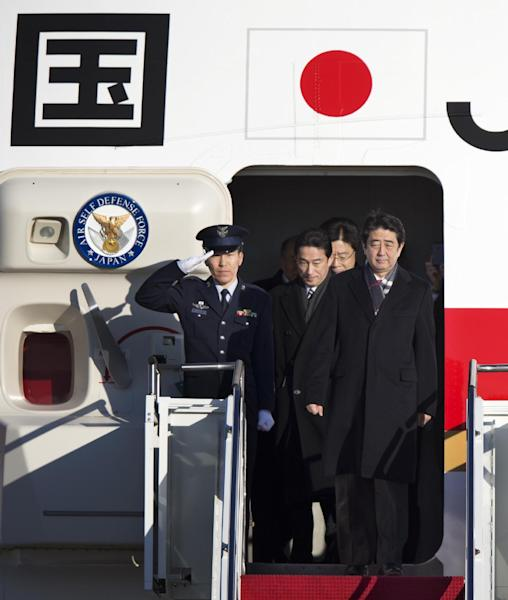 Japanese Prime Minister Shinzo Abe, arrives at Andrews Air Force Base, Md., Thursday, Feb. 21, 2013. The Japanese prime minister will meet with President Barack Obama on Friday. (AP Photo/Manuel Balce Ceneta)