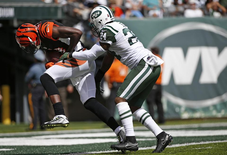 A.J. Green scores a touchdown against Darrelle Revis (AP)