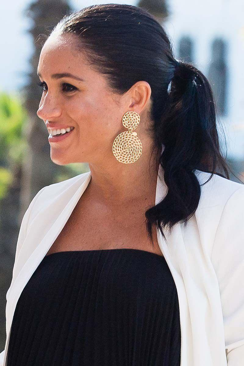 <p>Meghan paired her gold drop earrings with a ladylike ponytail during a royal visit to Morocco.</p>