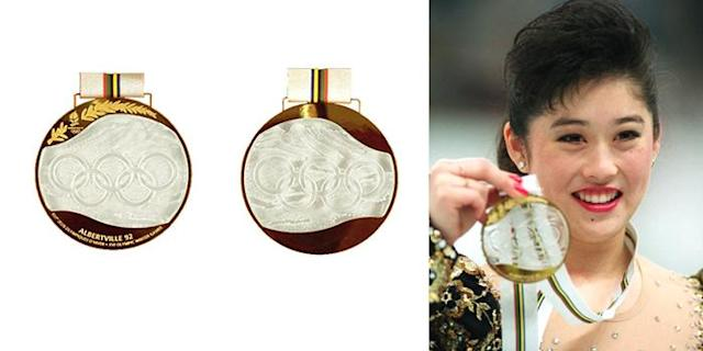 <p>Medals for the 1992 Winter Olympics in Albertville, France, were made with Lalique glass, set in gold, silver, and bronze, and completely hand-made.<br> (IOC photo; US gold medalist for Women's Figure Skating, Kristi Yamaguchi/photo by Junji Kurokawa/AFP/Getty Images) </p>