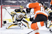 Boston Bruins goaltender Jeremy Swayman looks for the puck during the third period of an NHL hockey game against the Philadelphia Flyers, Tuesday, April 6, 2021, in Philadelphia. The Bruins won 4-2. (AP Photo/Derik Hamilton)