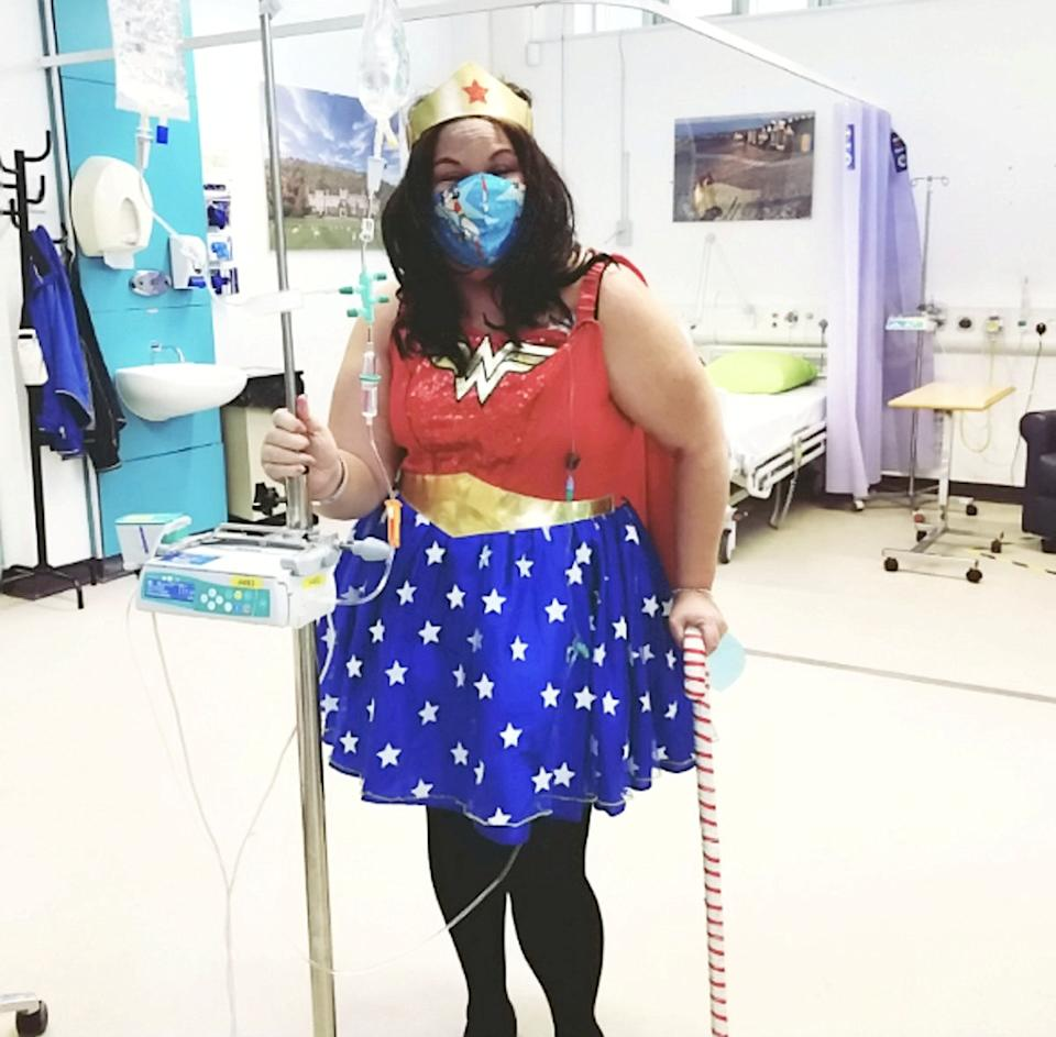 Heather Bone dressed as Wonder Woman during her cancer treatment. (SWNS)