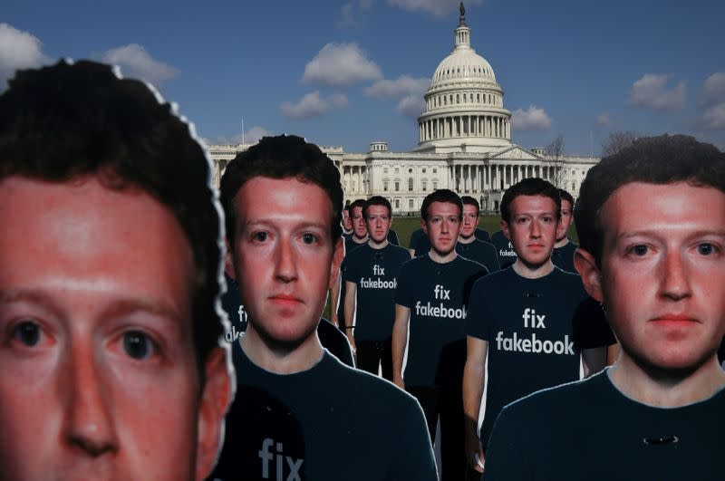 FILE PHOTO: Protesters from Avaaz.org set up dozens of cardboard cut-outs of Facebook CEO Mark Zuckerberg outside of the U.S. Capitol Building in Washington