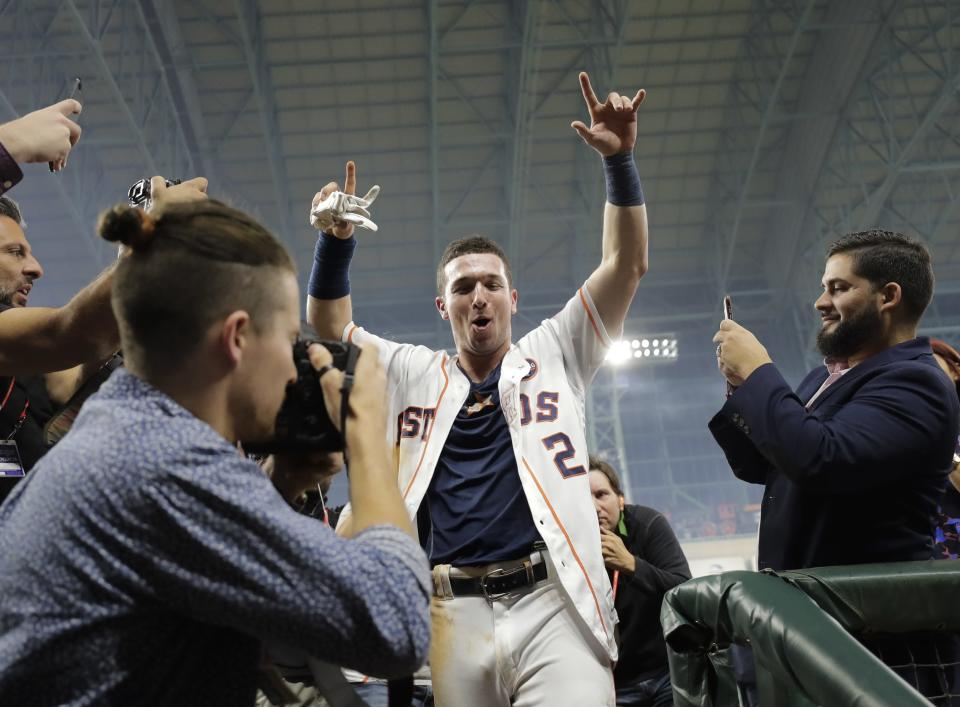 Alex Bregman celebrates after driving in the game-winning run during the 10th inning of Game 5. (AP)