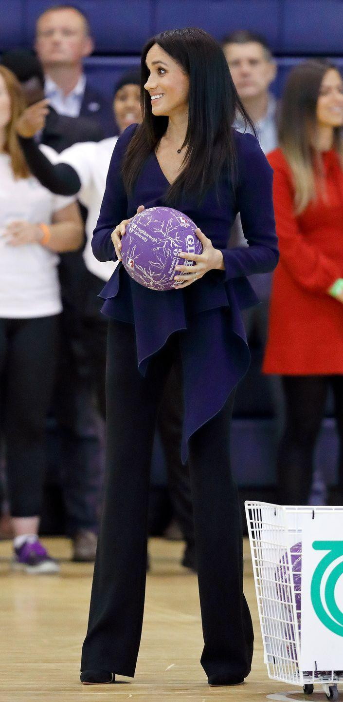 "<p>Meghan Markle took to the court in <a href=""https://www.townandcountrymag.com/style/fashion-trends/a23397186/meghan-markle-oscar-de-la-renta-shirt-outfit-coach-core-awards/"" rel=""nofollow noopener"" target=""_blank"" data-ylk=""slk:a blue Oscar de la Renta wrap blouse"" class=""link rapid-noclick-resp"">a blue Oscar de la Renta wrap blouse</a>, black trousers, and black stiletto pumps for an event celebrating the <a href=""https://www.townandcountrymag.com/society/tradition/g23396905/prince-harry-meghan-markle-coach-core-awards-photos/"" rel=""nofollow noopener"" target=""_blank"" data-ylk=""slk:Royal Foundation's Coach Core initiative."" class=""link rapid-noclick-resp"">Royal Foundation's Coach Core initiative.</a></p>"