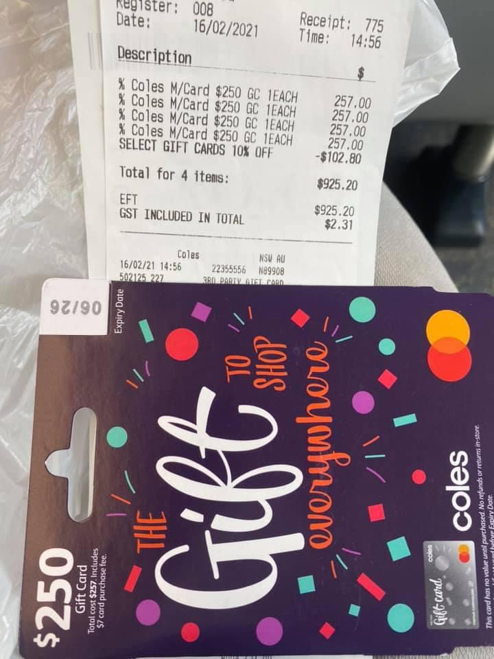 A shopper's recept shows the purchase of four Coles Mastercard gift cards.