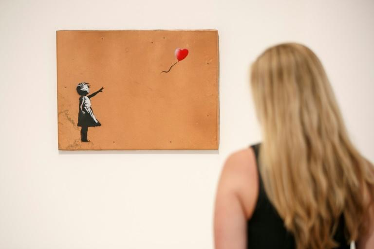 "Banksy's classic stencil ""Girl with Balloon"""