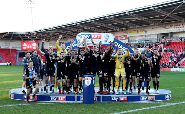 """Soccer Football - League One - Doncaster Rovers vs Wigan Athletic - Keepmoat Stadium, Doncaster, Britain - May 5, 2018 Wigan Athletic celebrate with the trophy after winning League One Action Images/John Clifton EDITORIAL USE ONLY. No use with unauthorized audio, video, data, fixture lists, club/league logos or """"live"""" services. Online in-match use limited to 75 images, no video emulation. No use in betting, games or single club/league/player publications. Please contact your account representative for further details."""