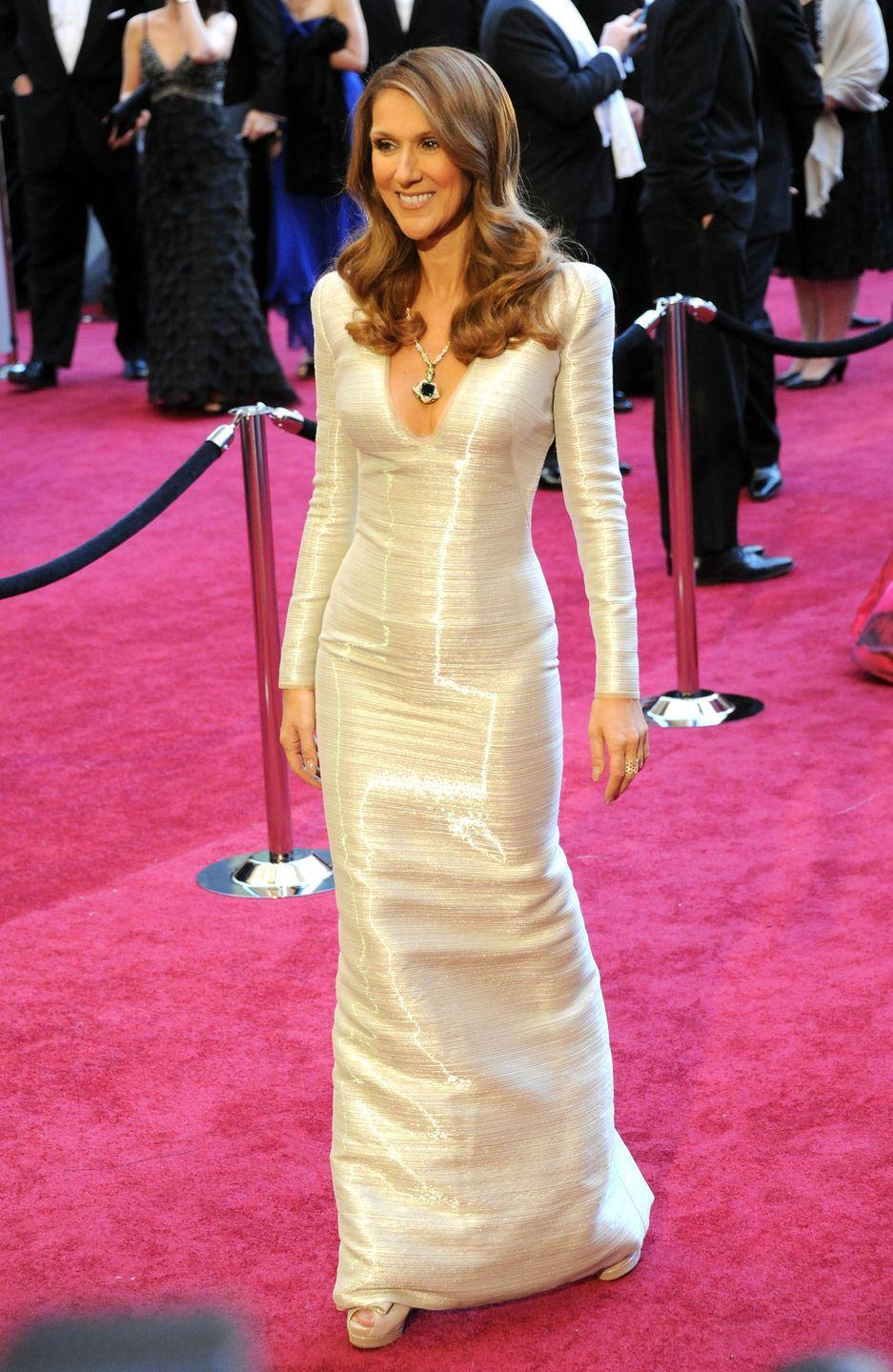 <p>Celine looked radiant on the Academy Awards red carpet in a form-fitting white gown. Her peep-toe heels match the dress impeccably, but the giant emerald around her neck stole the show.</p>
