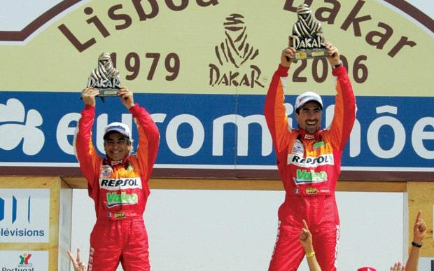 Alphand (right) and co-driver Gilles Picard celebrate winning the 2006 Dakar rally - Credit: 2006 AFP/DAMIEN MEYER