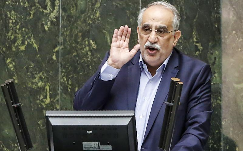 Masoud Karbasian, Iran's Economy Minister, speaks in the Iranian parliament before the vote that say him impeached - AFP