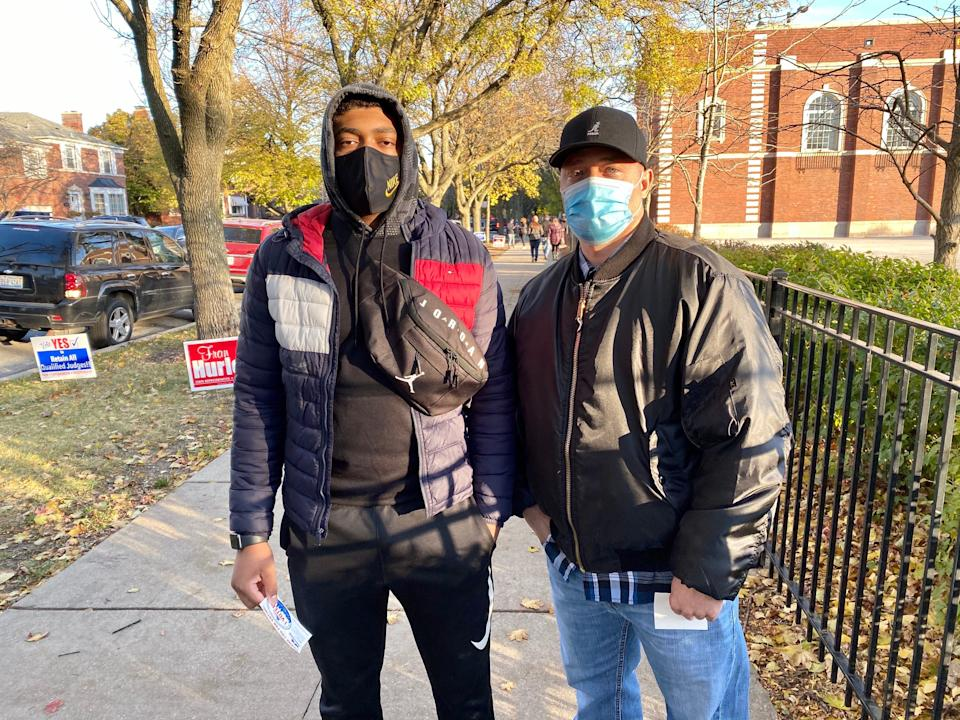 "Rasul Freelain, right, a police sergeant, and his son, Diata Freelain, voted for Joe Biden Tuesday at an elementary school on Chicago's Far Southwest Side. ""He has a sense of fairness and respectful interactions for all, regardless of what they may believe,"" said Rasul Freelain."