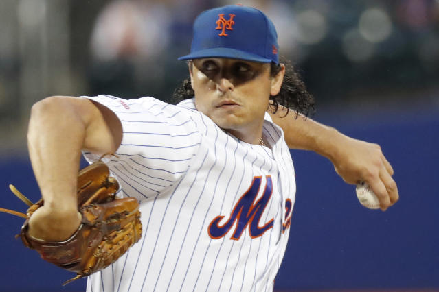 New York Mets starting pitcher Jason Vargas (44) winds up during the third inning of a baseball game against the San Diego Padres, Tuesday, July 23, 2019, in New York. (AP Photo/Kathy Willens)
