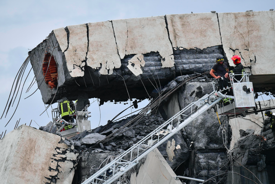 <em>Four people have so far been pulled out of the rubble alive (AP)</em>
