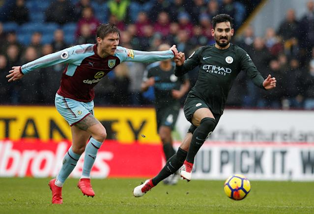 """Soccer Football - Premier League - Burnley vs Manchester City - Turf Moor, Burnley, Britain - February 3, 2018 Burnley's Jeff Hendrick in action with Manchester City's Ilkay Gundogan REUTERS/Andrew Yates EDITORIAL USE ONLY. No use with unauthorized audio, video, data, fixture lists, club/league logos or """"live"""" services. Online in-match use limited to 75 images, no video emulation. No use in betting, games or single club/league/player publications. Please contact your account representative for further details."""