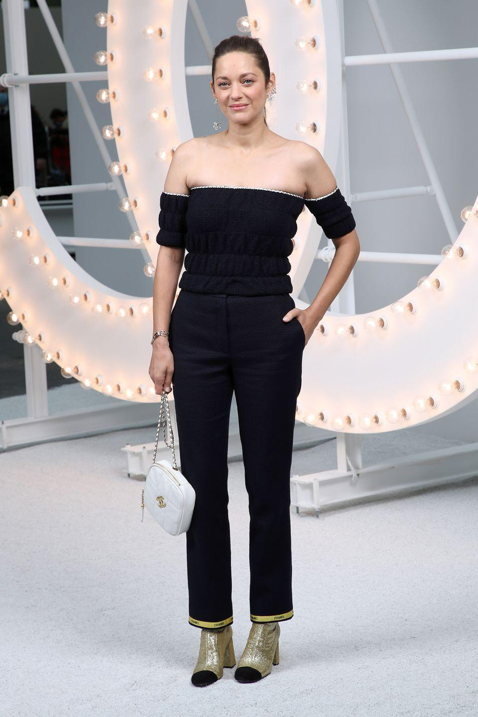 <p><strong>6 October </strong>Marion Cotillard kept things classic in an off-the-shoulder Chanel look and metallic boots. </p>