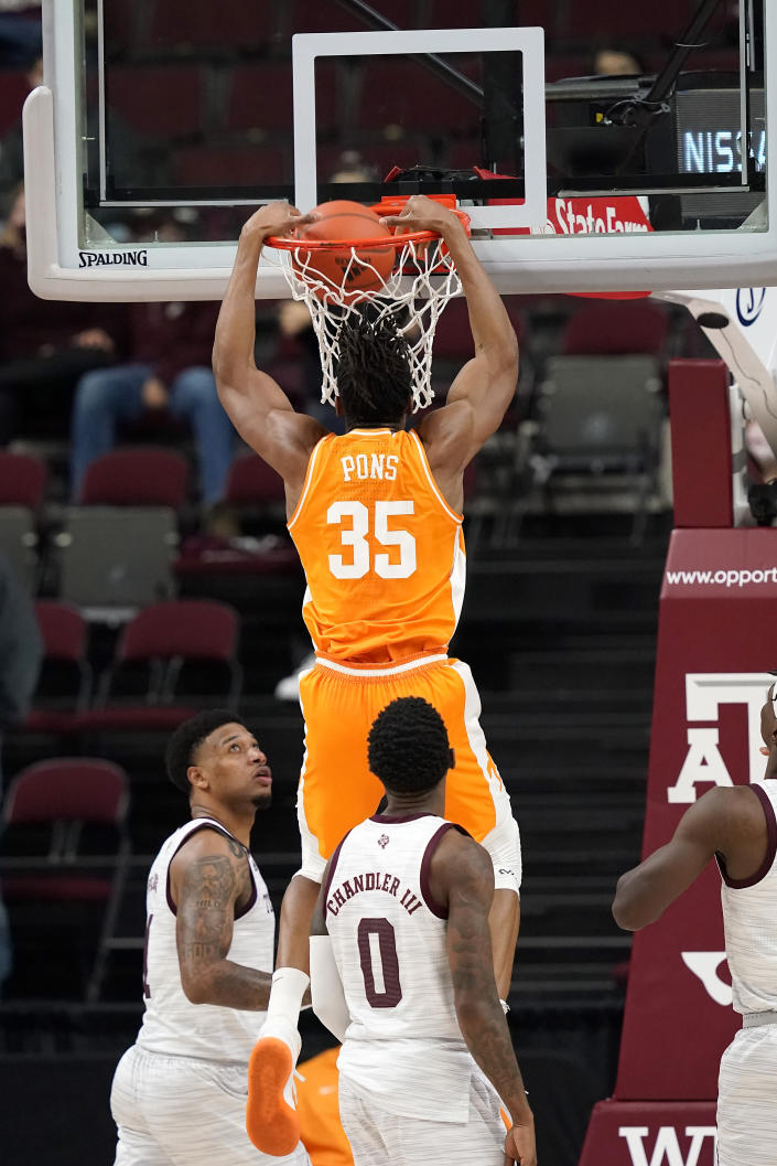 Tennessee guard Yves Pons (35) dunks over Texas A&M guard Savion Flagg (1) during the second half of an NCAA college basketball game Saturday, Jan. 9, 2021, in College Station, Texas. (AP Photo/Sam Craft)