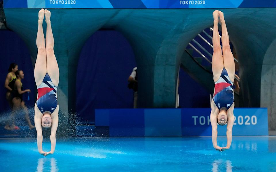 Grace Reid and Katherine Torrance of Britain compete during the Women's Synchronized 3m Springboard Final a - AP Photo/Dmitri Lovetsky