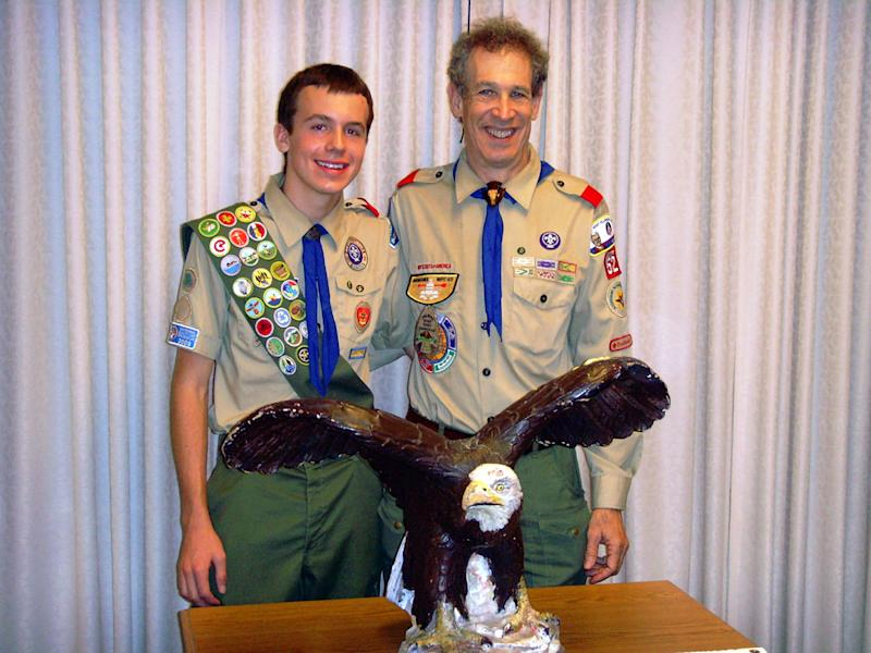 """In this June 17, 2010 photo provided by the family, Lucien Tessier and Scoutmaster Craig Iscoe pose for a photo at Lucien's Eagle Scout ceremony in Potomac, Md. """"I never had a single bad experience in Scouting,"""" said Lucien, who came out as gay to family and friends while a sophomore in high school. """"I never advertised it but never felt uncomfortable discussing it,"""" he said. """"It was never an issue as a Scout. ... It's always been a very welcoming troop."""" (AP Photo/Oliver Tessier)"""