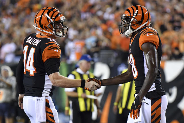 Cincinnati Bengals wide receiver A.J. Green, right, celebrates with quarterback Andy Dalton (14) after scoring a touchdown in the first half of an NFL football game, Thursday, Sept. 13, 2018, in Cincinnati. (AP Photo/Bryan Woolston)