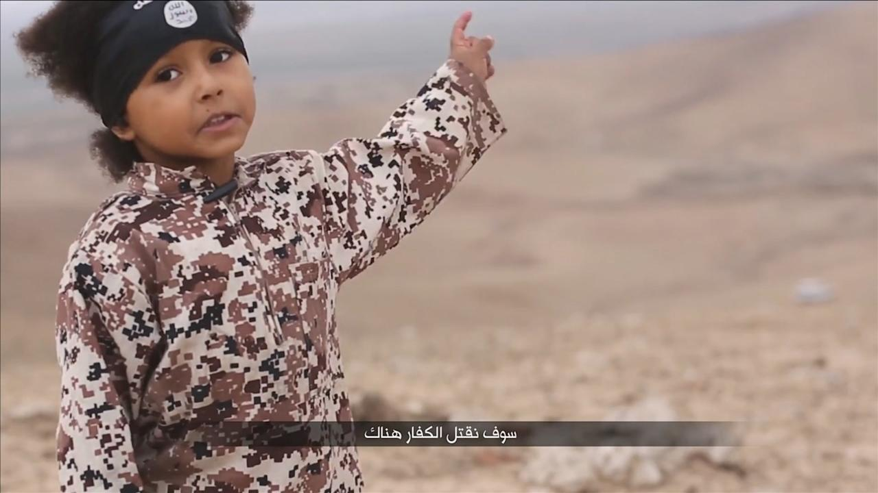 A child speaks in this still image from a handout video obtained on January 4, 2016 from a social media website which has not been independently verified. Britain was on Monday examining the Islamic State video showing a young boy in military fatigues and an older masked militant who both spoke with British accents. The propaganda video, which could not be independently verified, also shows the killing of five men accused of spying for the West.   REUTERS/Social Media via Reuters TVATTENTION EDITORS - THIS IMAGE HAS BEEN SUPPLIED BY A THIRD PARTY. IT IS DISTRIBUTED, EXACTLY AS RECEIVED BY REUTERS, AS A SERVICE TO CLIENTS. REUTERS IS UNABLE TO INDEPENDENTLY VERIFY THE AUTHENTICITY, CONTENT, LOCATION OR DATE OF THIS IMAGE. FOR EDITORIAL USE ONLY. NOT FOR SALE FOR MARKETING OR ADVERTISING CAMPAIGNS. NO RESALES. NO ARCHIVE. THIS EDIT CONTAINS USER GENERATED CONTENT THAT WAS UPLOADED TO A SOCIAL MEDIA WEBSITE. IT HAS BEEN CHECKED BY REUTERS' SOCIAL MEDIA TEAM AND REVIEWED BY A SENIOR EDITOR. REUTERS IS CONFIDENT THE EVENTS PORTRAYED ARE GENUINE.       TPX IMAGES OF THE DAY