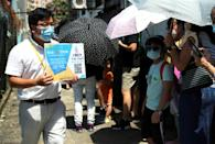 Thousands queued in the intense summer heat at unofficial polling stations across the city hours after police raided an opinion pollster helping to conduct the vote