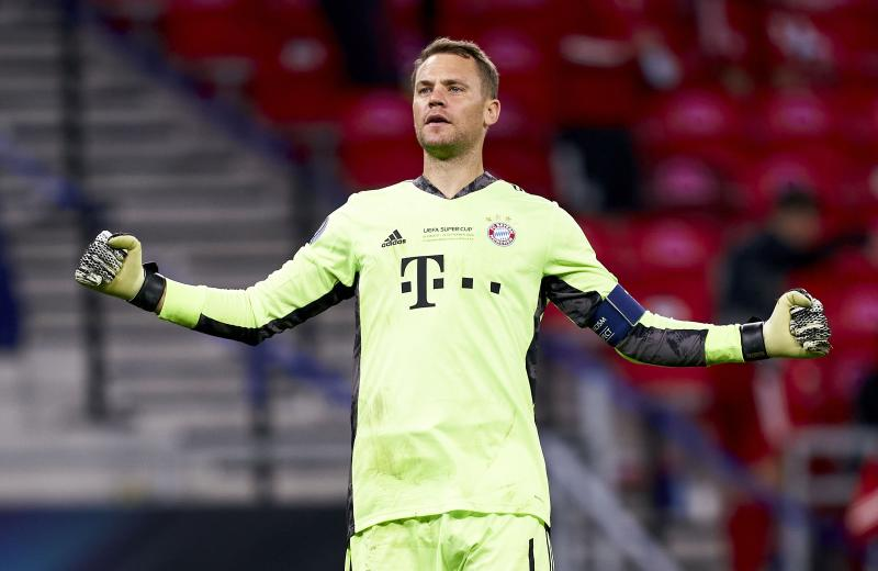 BUDAPEST, HUNGARY - SEPTEMBER 24: Manuel Neuer of FC Bayern Munich celebrates after the second goal of his team scored by Javi Martinez (not in frame) during the UEFA Super Cup match between FC Bayern Munich and FC Sevilla at Puskas Arena on September 24, 2020 in Budapest, Hungary. Football Stadiums around Europe remain empty due to the Coronavirus Pandemic as Government social distancing laws prohibit fans inside venues resulting in fixtures being played behind closed doors. (Photo by Mateo Villalba/Quality Sport Images/Getty Images)
