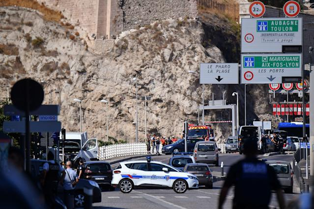 <p>French forensic police officers and security personnel gather near a vehicle following a car crash in the southern Mediterranean city of Marseille on Aug. 21, 2017. (Photo: Bertrand Langlois/AFP/Getty Images) </p>