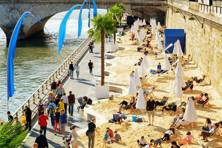 The Paris Plage – a sandy beach with potted palms overlooking the River Seine.