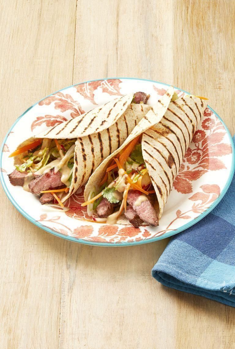 """<p>Blend creamy peanut butter and canned coconut milk with lime juice, fish sauce, chili oil, garlic, and ginger to make this tasty sauce. Try it on a steak wrap, and save any leftovers for drizzling on salads or serving as a veggie dip. </p><p><a href=""""https://www.thepioneerwoman.com/food-cooking/recipes/a32501112/grilled-steak-wraps-with-peanut-sauce-recipe/"""" rel=""""nofollow noopener"""" target=""""_blank"""" data-ylk=""""slk:Get Ree's recipe."""" class=""""link rapid-noclick-resp""""><strong>Get Ree's recipe.</strong></a></p><p><a class=""""link rapid-noclick-resp"""" href=""""https://go.redirectingat.com?id=74968X1596630&url=https%3A%2F%2Fwww.walmart.com%2Fbrowse%2Fhome%2Fblenders%2F4044_90548_90546_4831&sref=https%3A%2F%2Fwww.thepioneerwoman.com%2Ffood-cooking%2Frecipes%2Fg36383850%2Fsteak-sauce-recipes%2F"""" rel=""""nofollow noopener"""" target=""""_blank"""" data-ylk=""""slk:SHOP BLENDERS"""">SHOP BLENDERS</a></p>"""