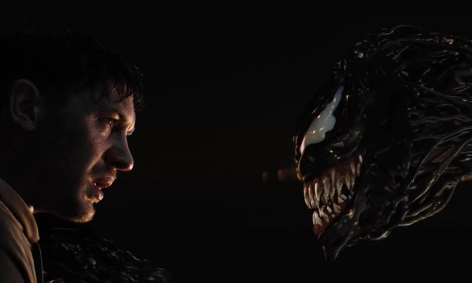 A still captured from the first Venom movie in which the main character Eddie Brock comes face-to-face with the symbiote Venom for the first time