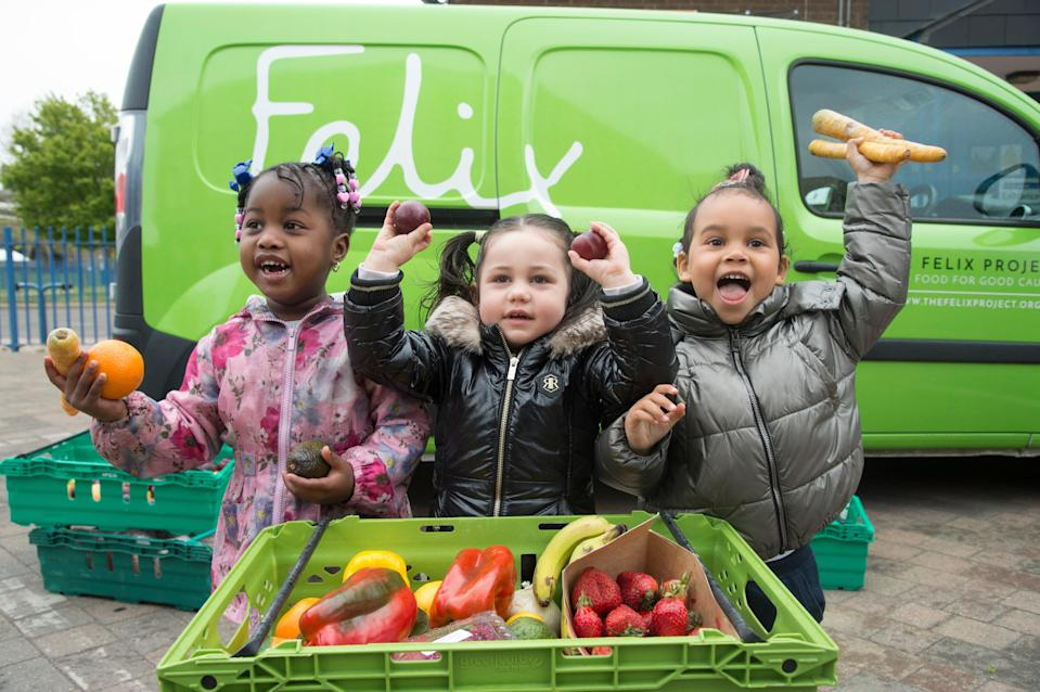 <p>Fresh boost: three-year-olds Dream, Aaliyah, and Eva Rosie all receive fruit and veg from The Felix Project, which will run our new social kitchen</p> (Jeremy Selwyn)
