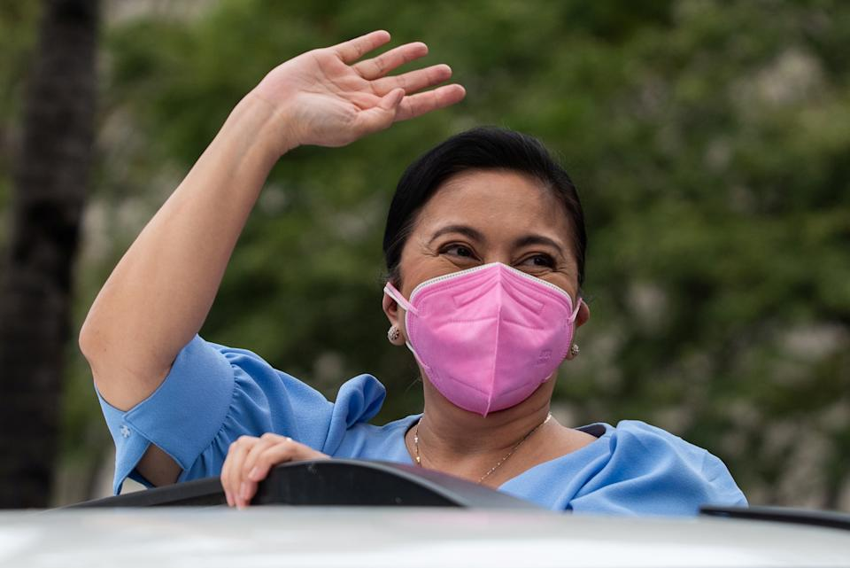 """FILE PHOTO: Vice President Maria Leonor """"Leni"""" Robredo gestures on her way to file her candidacy for president, in Pasay City, Metro Manila, Philippines, October 7, 2021. (Source: REUTERS/Lisa Marie David)"""