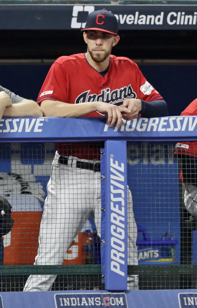 Cleveland Indians' Bradley Zimmer watches from the dugout in the second inning in a baseball game against the Minnesota Twins, Friday, Sept. 13, 2019, in Cleveland. (AP Photo/Tony Dejak)