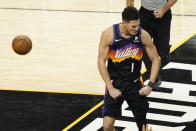 Phoenix Suns guard Devin Booker (1) reacts during the first half of Game 5 of basketball's NBA Finals against the Milwaukee Bucks, Saturday, July 17, 2021, in Phoenix. (AP Photo/Matt York)
