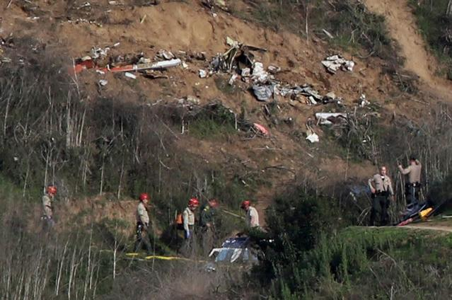 FILE PHOTO: Sheriffs and officials investigate the helicopter crash site of NBA star Kobe Bryant in Calabasas, California