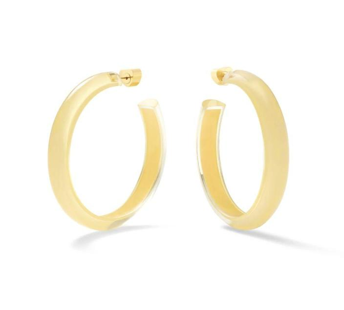 """<p>alisonlou.com</p><p><strong>$145.00</strong></p><p><a href=""""https://www.alisonlou.com/products/medium-jelly-hoops-summer19"""" rel=""""nofollow noopener"""" target=""""_blank"""" data-ylk=""""slk:Shop Now"""" class=""""link rapid-noclick-resp"""">Shop Now</a></p><p>Add a splash of fun to mom's wardrobe with a pair of lucite hoops in whatever color she loves best. Pure joy in a jewel. </p>"""