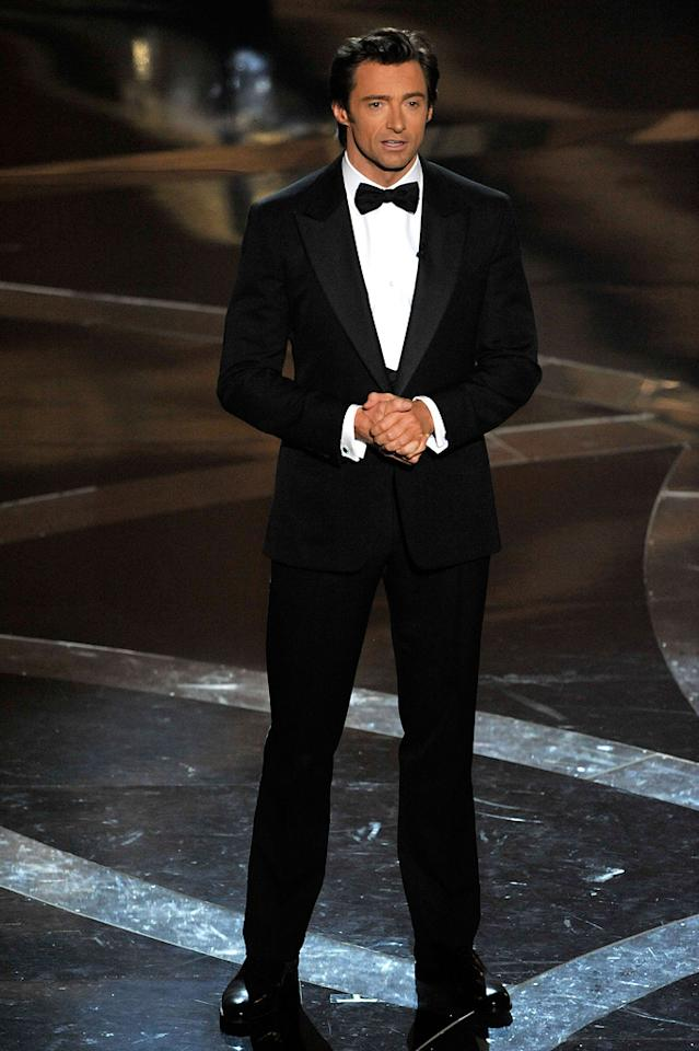 Hugh Jackman   Grade: A       The show's host looked hotter than ever in a custom-made three-piece tuxedo complete with a Burberry dress shirt and Salvatore Ferragamo shoes.