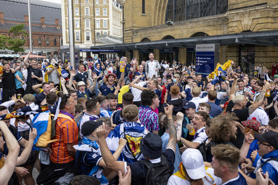 LONDON, ENGLAND - JUNE 17: Scotland fans chanting outside King's Cross Station on June 17, 2021 in London, England. Officials in Scotland and London, where the match will be hosted at Wembley Stadium, have discouraged Scottish fans without tickets to the game of coming south, due to concerns about the spread of Covid-19. (Photo by Rob Pinney/Getty Images)
