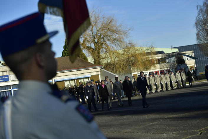 French President Emmanuel Macron arrives for a ceremony in tribute to French soldiers who died in Mali helicopter crash, Monday Jan.13, 2020 in Pau, southwestern France. France is preparing its military to better target Islamic extremists in a West African region that has seen a surge of deadly violence. (AP Photo/Alvaro Barrientos, Pool)