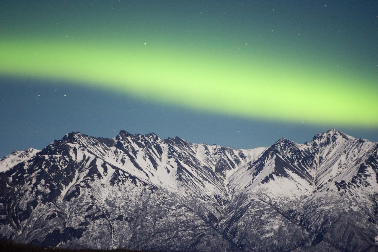 A band of Aurora Borealis, the Northern Lights, stretches over the Chugach Range near Palmer, Alaska in this February file photo. Scientists think they have discovered the energy source of the spectacular color displays seen in the northern lights. (AP Photo/Bob Martinson, FILE)