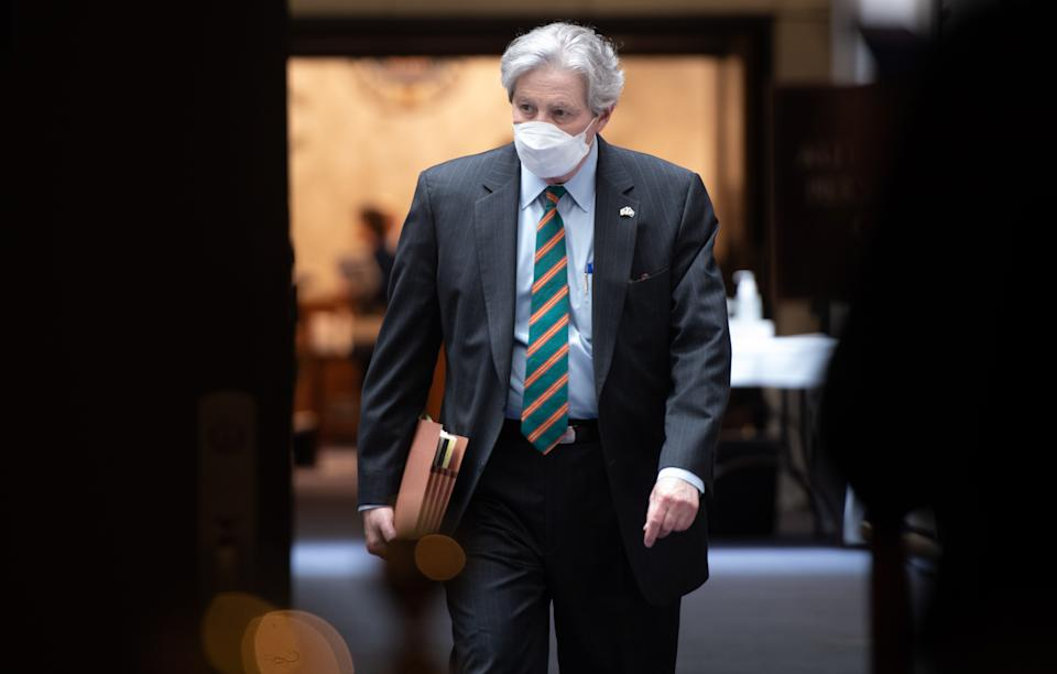 US Senator John Kennedy, Republican of Louisiana, wearing a mask to protect himself and others from COVID-19, known as coronavirus, leaves following the weekly Republican policy luncheon on Capitol Hill in Washington, DC, May 5, 2020. (Photo by SAUL LOEB / AFP) (Photo by SAUL LOEB/AFP via Getty Images)