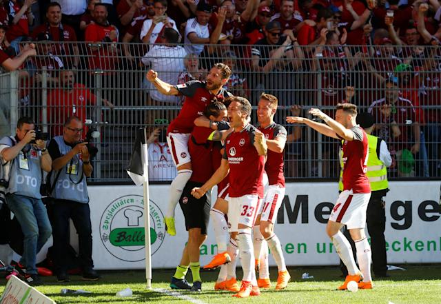 Soccer Football - 2. Bundesliga - SV Sandhausen v Nuremberg - BWT-Stadion am Hardtwald, Sandhausen, Germany - May 6, 2018 Nurnberg 's Tim Leibold celebrates scoring their second goal with team mates REUTERS/Kai Pfaffenbach DFL RULES TO LIMIT THE ONLINE USAGE DURING MATCH TIME TO 15 PICTURES PER GAME. IMAGE SEQUENCES TO SIMULATE VIDEO IS NOT ALLOWED AT ANY TIME. FOR FURTHER QUERIES PLEASE CONTACT DFL DIRECTLY AT + 49 69 650050