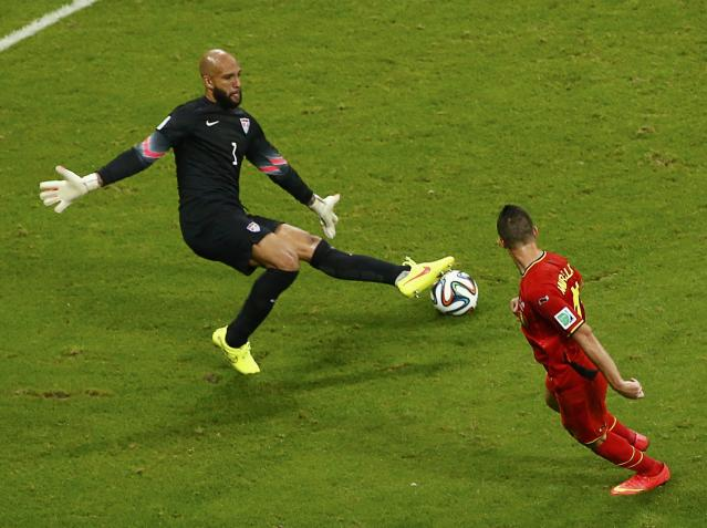 Goalkeeper Howard of the U.S. blocks a shot by Belgium's Mirallas during their 2014 World Cup round of 16 game at the Fonte Nova arena in Salvador