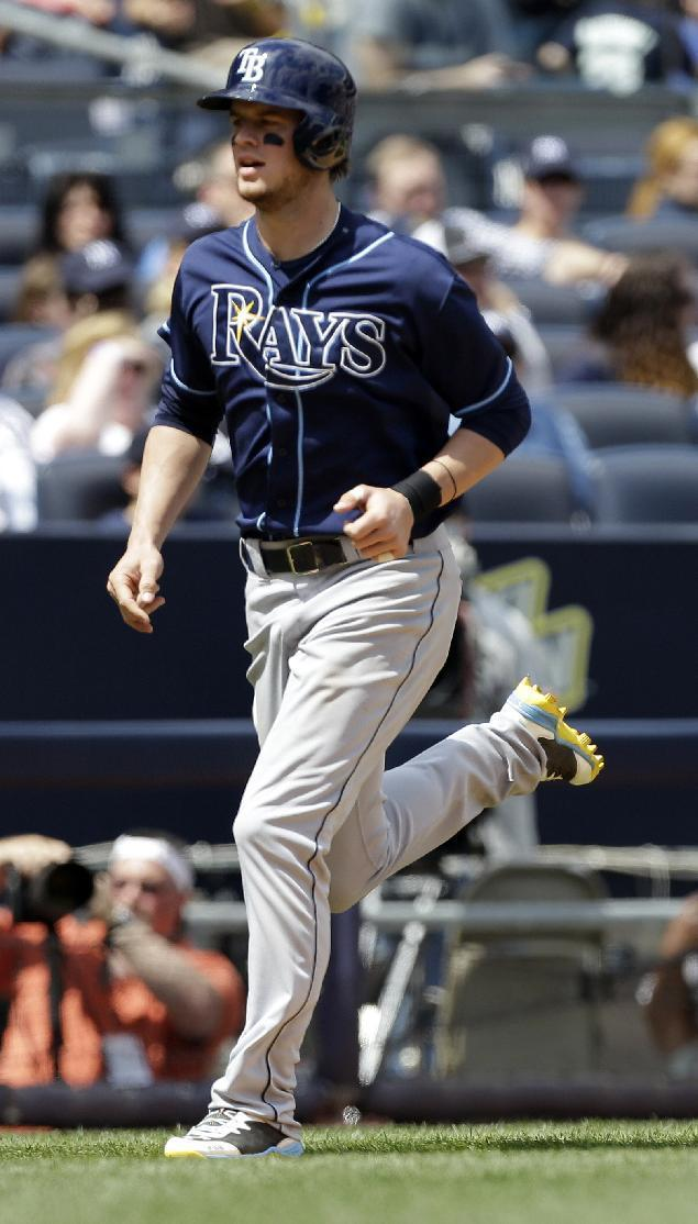 Tampa Bay Rays' Wil Myers runs to home plate after hitting a home run during the fourth inning of a baseball game against the New York Yankees Saturday, May 3, 2014, in New York. (AP Photo/Frank Franklin II)