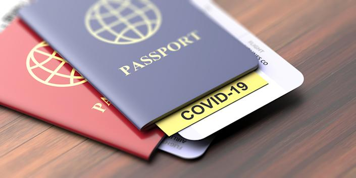 Coronavirus and travel concept. COVID-19 note on a passport. Border control and tourists infected quarantine, Travelling documents on wooden table, closeup view. 3d illustration