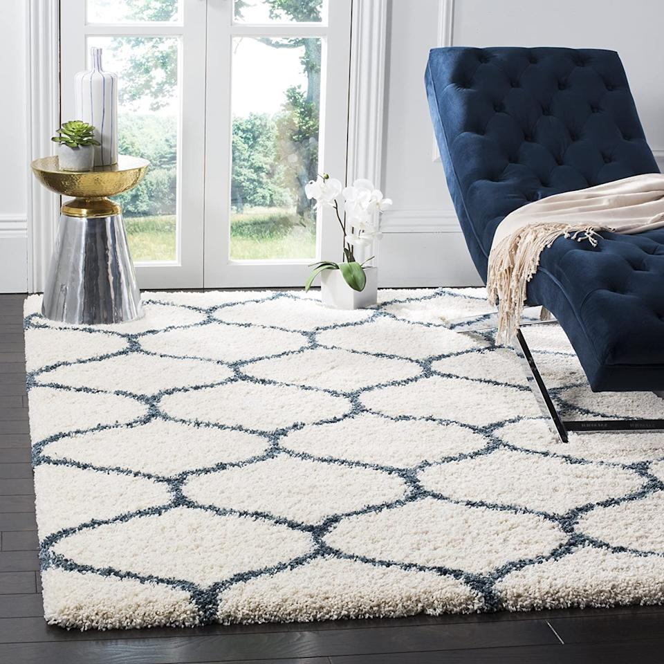 """<h2><a href=""""https://www.amazon.com/dp/B01M0R3UCX/ref=sspa_dk_detail_2?"""" rel=""""nofollow noopener"""" target=""""_blank"""" data-ylk=""""slk:Safavieh Hudson Shag Collection Moroccan Area Rug"""" class=""""link rapid-noclick-resp"""">Safavieh Hudson Shag Collection Moroccan Area Rug</a></h2><br>A classic rug that'll seamlessly complement every living room aesthetic. With over 2000 Amazon reviews, it's safe to say that this is a fan favorite. <br><br><strong>Safavieh</strong> Safavieh Hudson Shag Collection Moroccan Area Rug, $, available at <a href=""""https://www.amazon.com/dp/B01M0R3UCX/ref=sspa_dk_detail_2?pd_rd_i=B00PU15VM6&pd_rd_w=zflZv&pf_rd_p=f0355a48-7e73-489a-9590-564e12837b93&pd_rd_wg=5HwQ0&pf_rd_r=G9WZDJDNZY392GXJN9Y2&pd_rd_r=ca940b1c-0818-4cec-8a4a-2b702217a9e8&spLa=ZW5jcnlwdGVkUXVhbGlmaWVyPUEySk9WRzZUNDdIVENFJmVuY3J5cHRlZElkPUEwMDYwMDAzMVFTVzdOSUs0RDNCMyZlbmNyeXB0ZWRBZElkPUEwMTYxNjQ3MlpYN1pTTUNLUFpNWSZ3aWRnZXROYW1lPXNwX2RldGFpbF90aGVtYXRpYyZhY3Rpb249Y2xpY2tSZWRpcmVjdCZkb05vdExvZ0NsaWNrPXRydWU&th=1"""" rel=""""nofollow noopener"""" target=""""_blank"""" data-ylk=""""slk:Amazon"""" class=""""link rapid-noclick-resp"""">Amazon</a>"""